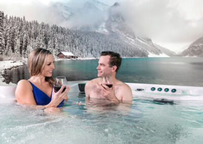 A couple drinking in the hot tub