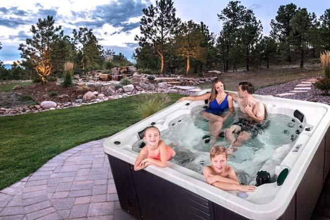 man in an Otter Arctic Spas hot tub
