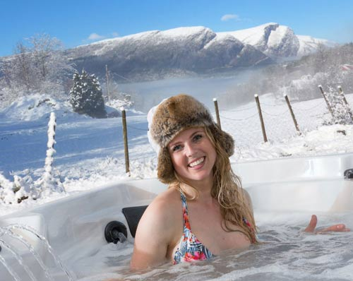 A woman relaxing in the arctic spas hot tub