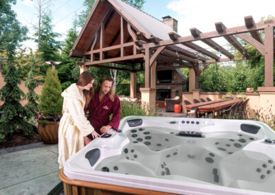 couple connecting internet to and Arctic Spas hot tub