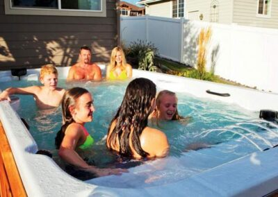 Family having fun in an Artic Spas All Weather pool