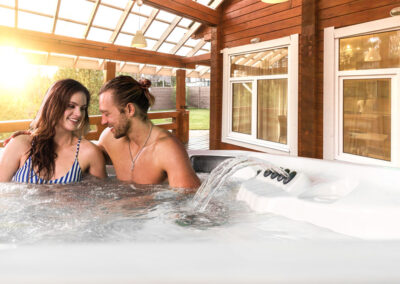Couple relaxing in an Arctic Spas hot tub